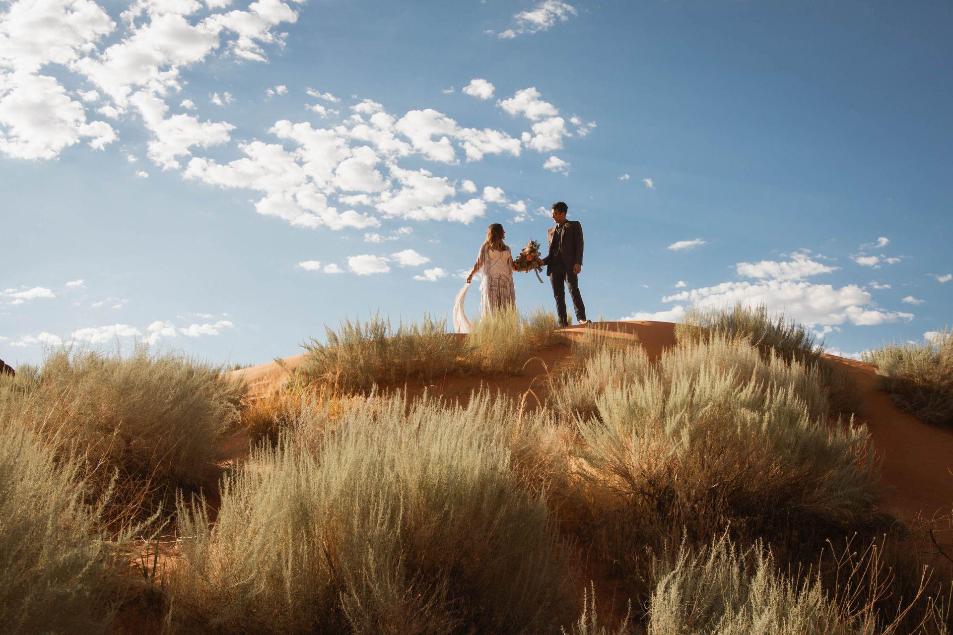 Elopement wedding utah desert - couple on top of sand dune