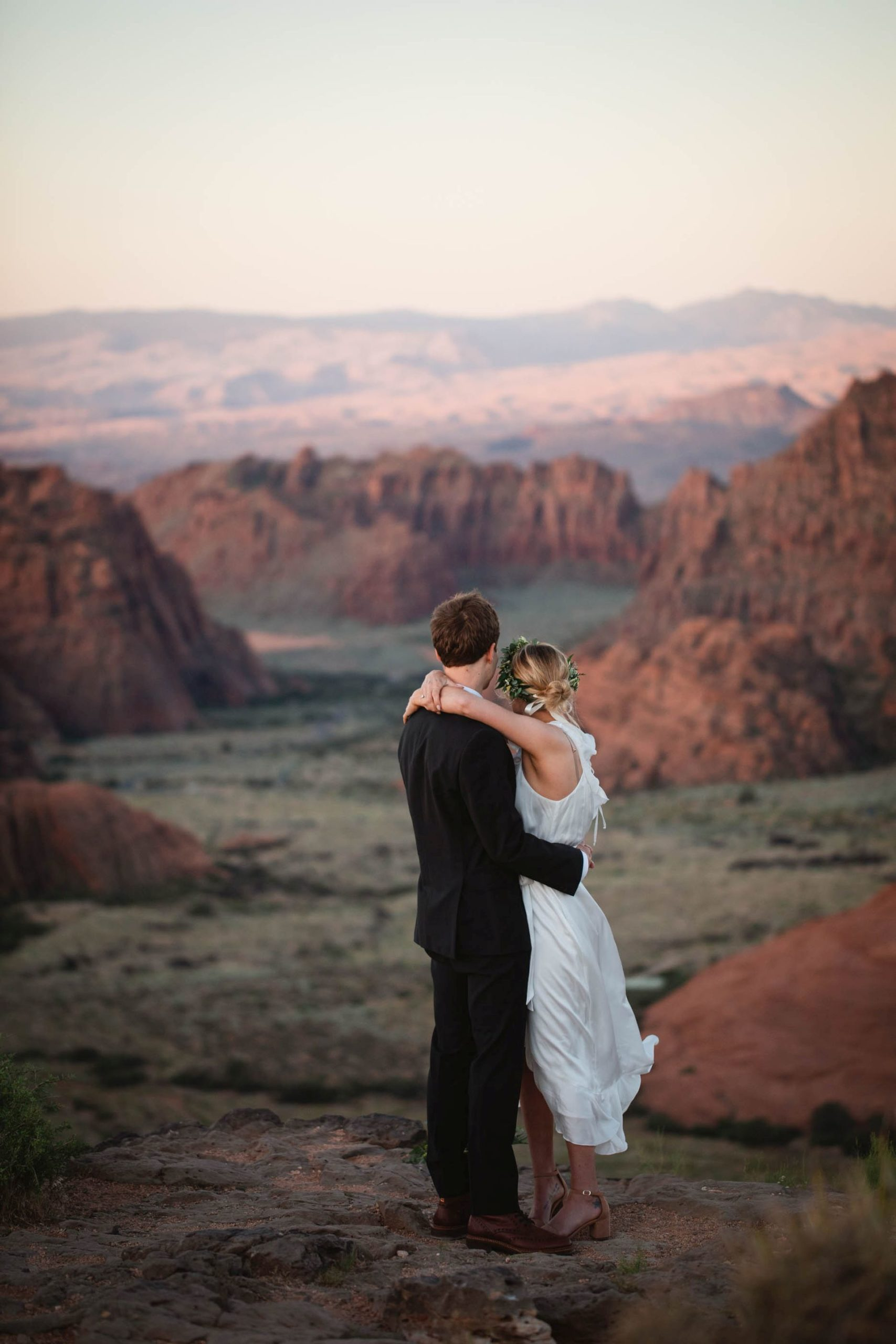 hike-out wedding utah desert - couple in front of desert views at sunset