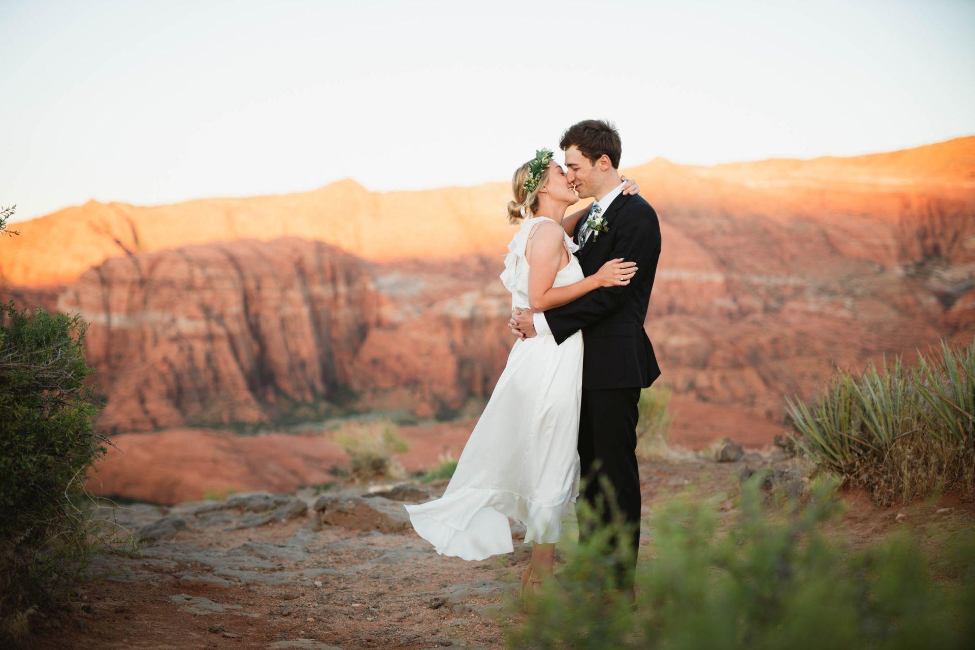 Hike Out wedding at Utah Desert - Bride and Groom kissing