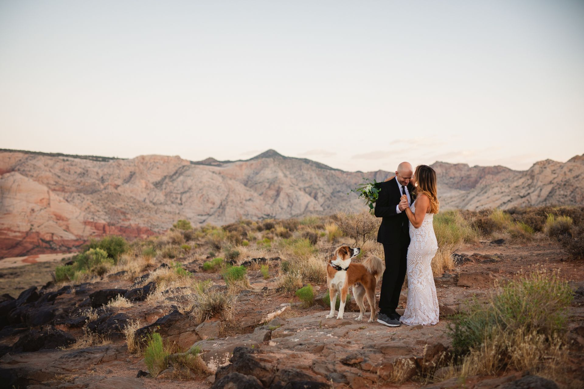 hiking elopement utah desert - bride and groom dancing in the desert