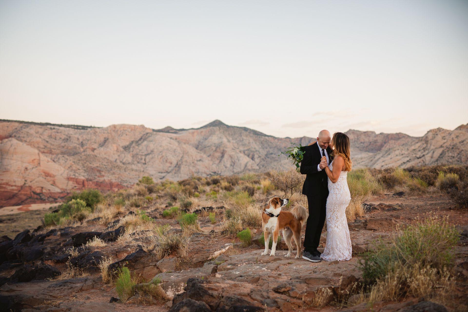 hiking elopement utah desert - bride and groom dancing in the desert